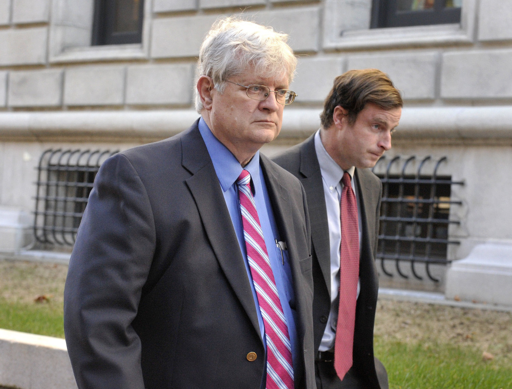 Dr. Joel Sabean and one of his lawyers, Albert C. Frawley, leave the federal courthouse in Portland after his conviction in November.