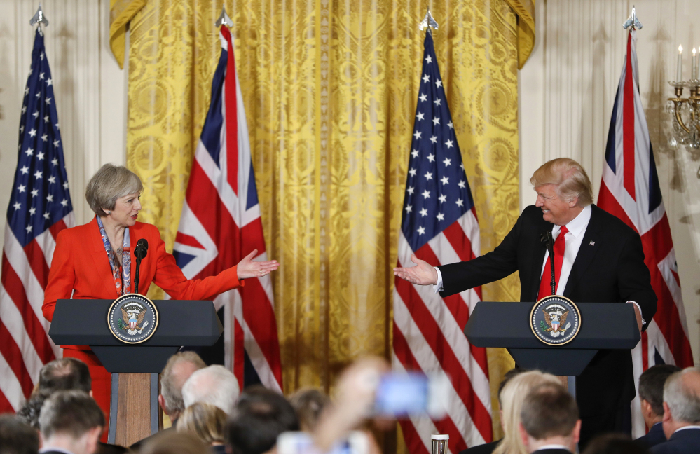 President Trump and British Prime Minister Theresa May appear at a joint news conference in the East Room of the White House in Washington on Friday.