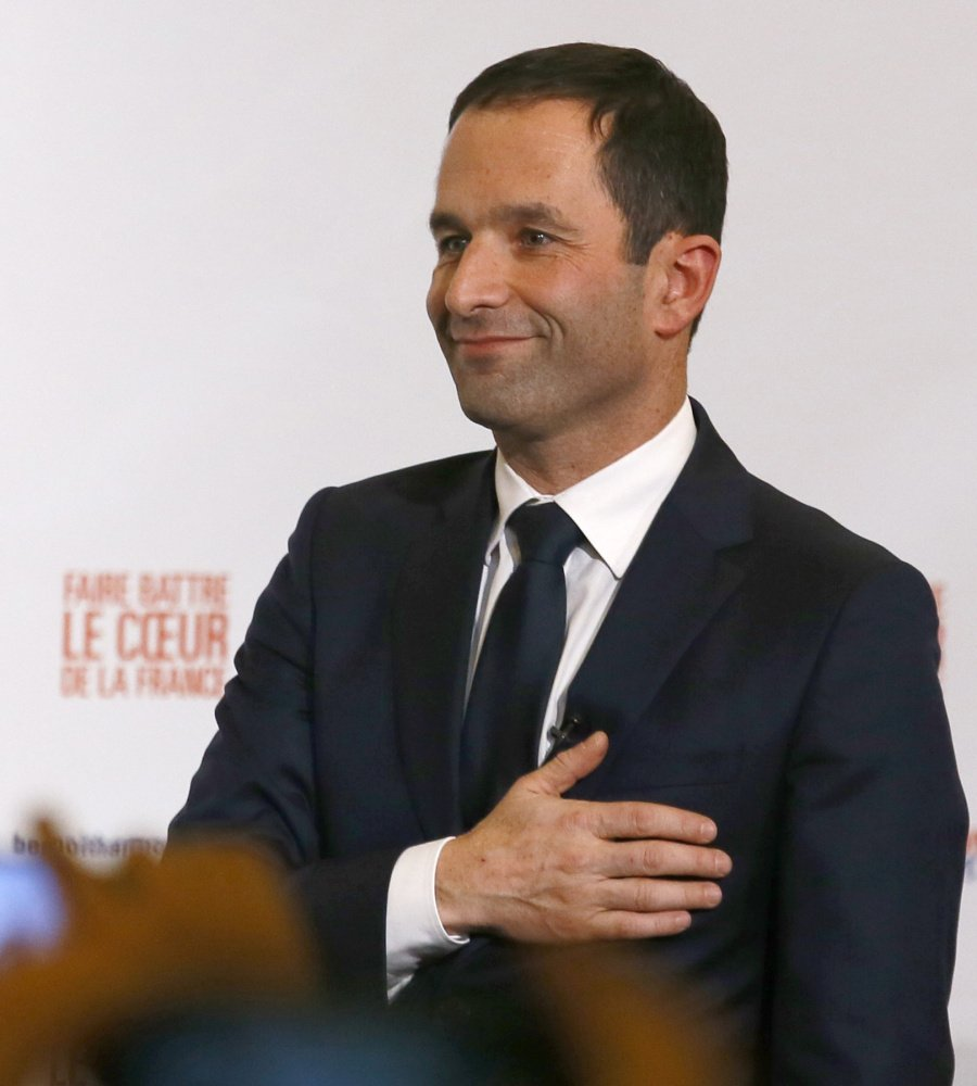 Candidate for the French left's presidential primaries Benoit Hamon greets supporters after winning the Socialist Party presidential nomination Sunday.