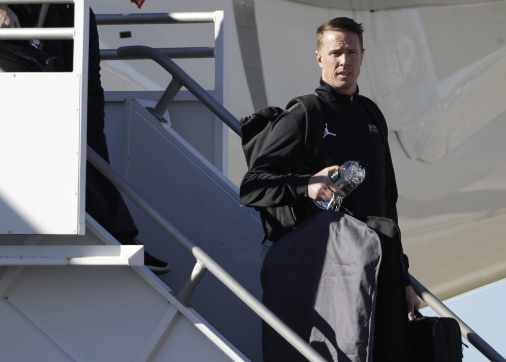 Falcons quarter Matt Ryan leaves the plane after the team arrived at Houston's George Bush Intercontinental Airport Sunday in advance of the Super Bowl.