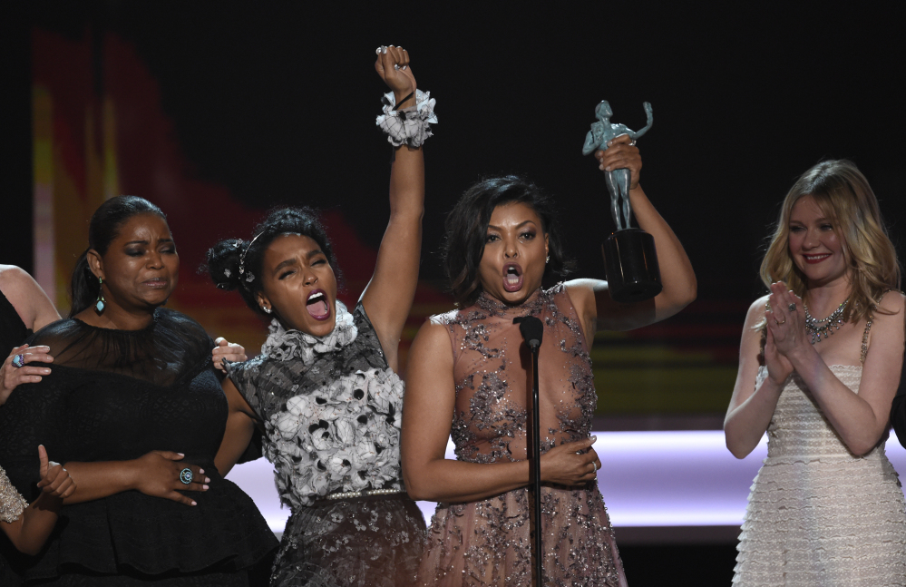 "Octavia Spencer, Janelle Monae, Taraji P. Henson and Kirsten Dunst accept the award for outstanding performance by a cast in a motion picture for ""Hidden Figures"" at the 23rd annual Screen Actors Guild Awards on Sunday in Los Angeles. (Chris Pizzello/Invision/AP)"