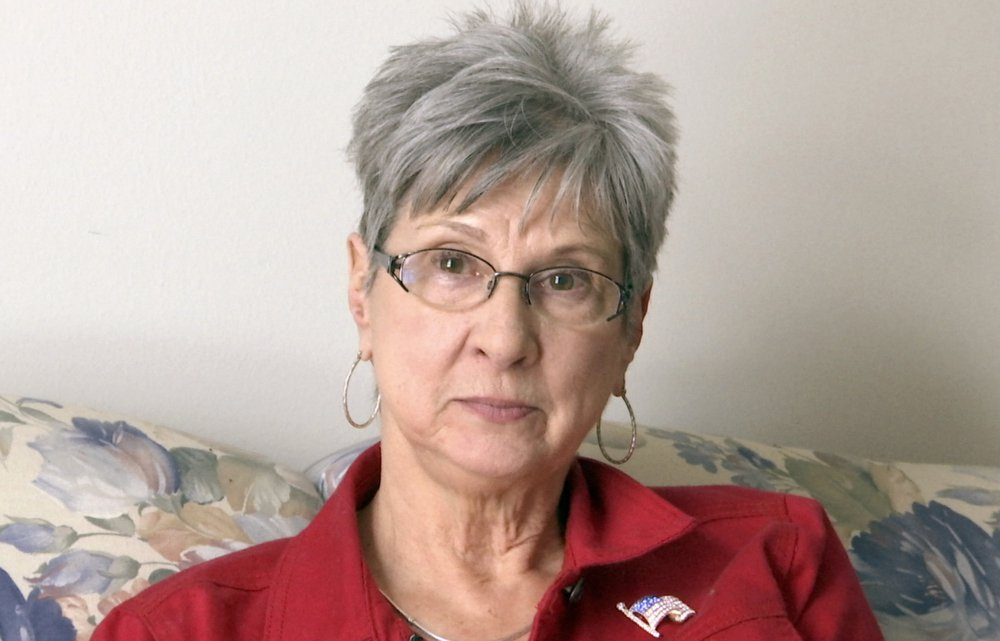 """Barbara Van Syckel is interviewed in Sterling Heights, Mich., on Monday. Van Syckel said President Trump is """"going to do what he says and says what he does."""" The 66-year-old says """"that's a little frightening for some people."""""""