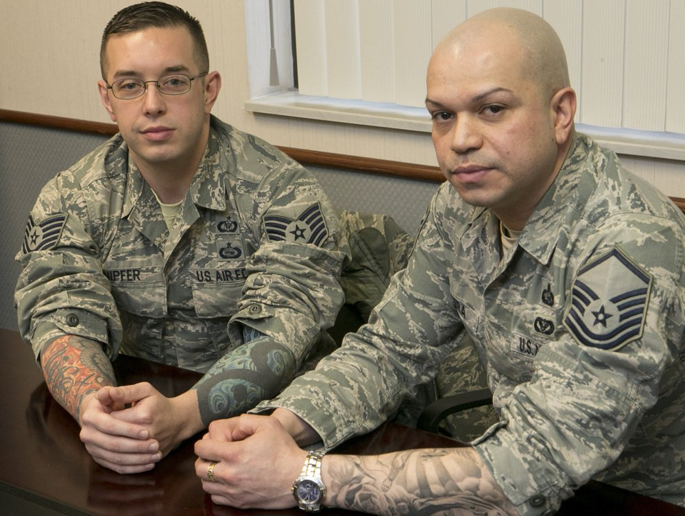 Sgts. Robert Knipfer and Joseph Rivera show their tattoos at Scott Air Force Base in Illinois. A new Air Force policy takes effect Wednesday.