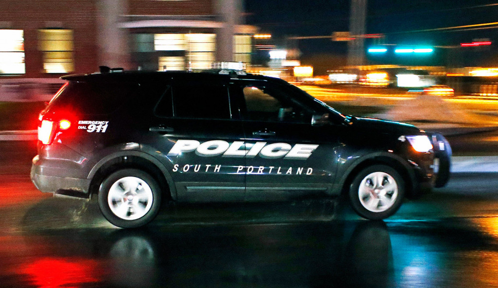 A South Portland police vehicle leaves the police station Wednesday night. The city's officers will soon be equipped with body cameras.