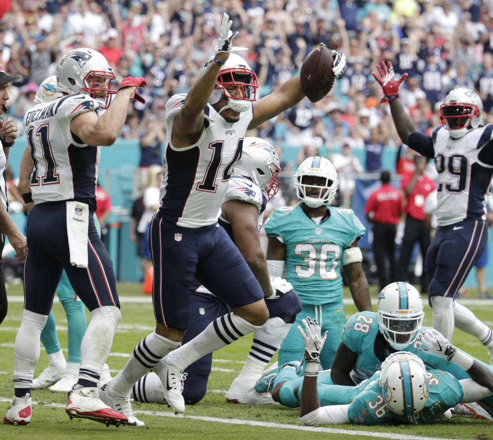 New England Patriots wide receiver Michael Floyd (14) celebrates his touchdown, during the first half against the Miami Dolphins on Sunday in Miami Gardens, Florida.