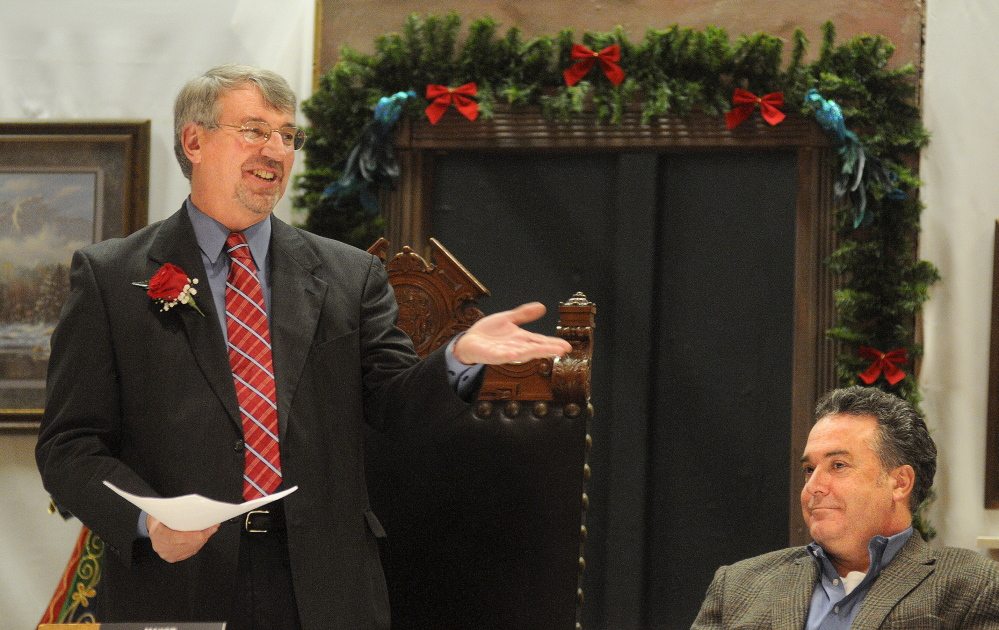 Hallowell City Councilor Alan Stearns, right, listens to Mark Walker's inaugural speech in 2014 after being sworn in as the city's mayor. Stearns opted not to run for re-election and will be replaced on the council by Lynn Irish, while Walker will give another mayoral address Tuesday night.