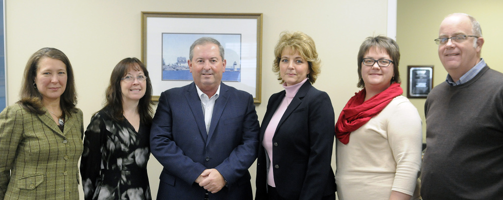 Performance Foodservice — NorthCenter executive team are, from left, Joyce Sawtelle, Vanessa Matthews, President Greg Piper, Bonnie Savage, Michele Pelletier and Jim Mahoney at the firm's office in Augusta on Dec. 20.