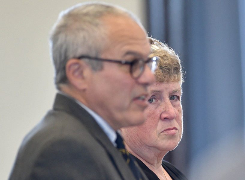 Julie Smith, right, stands with her attorney Woody Hanstein in Somerset County Superior Court in Skowhegan in May when she pleaded guilty to embezzling $90,000 from the Somerset County office of district attorney.