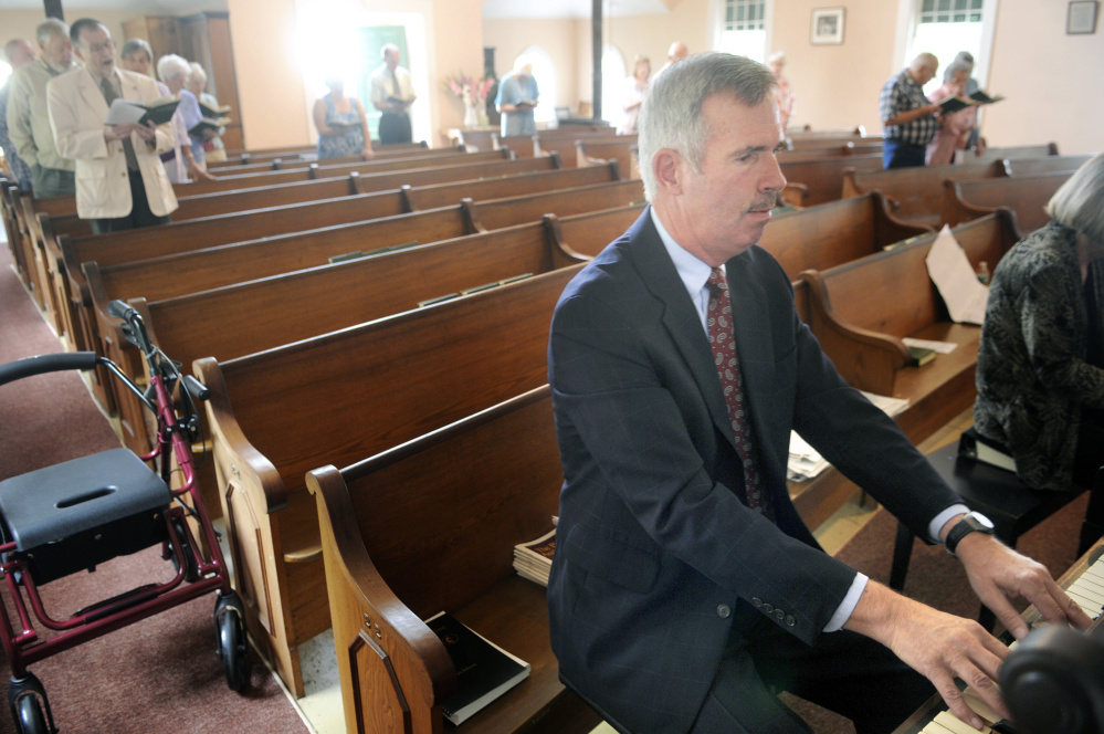 Mark Johnston plays the organ during Sunday service Aug. 28 at the Bunker Hill Baptist Church in Jefferson, where he has played the organ and piano for 50 years.