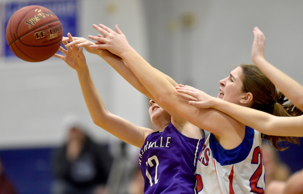 Messalonskee's McKenna Brodeur, right, battles for a rebound with Waterville's Lily Foster (12) on Wednesday in Oakland.
