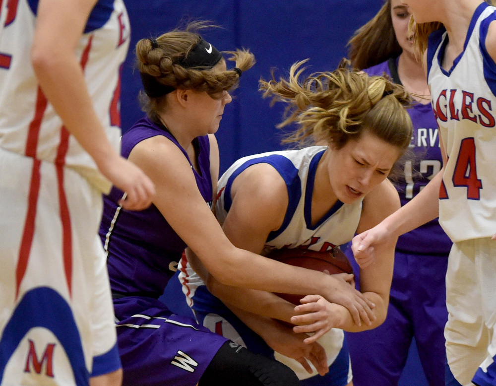 Messalonskee's  Sophie Holmes, center right, battles for a loose ball with Waterville's Maddie Martin, left, Wednesday in Oakland.