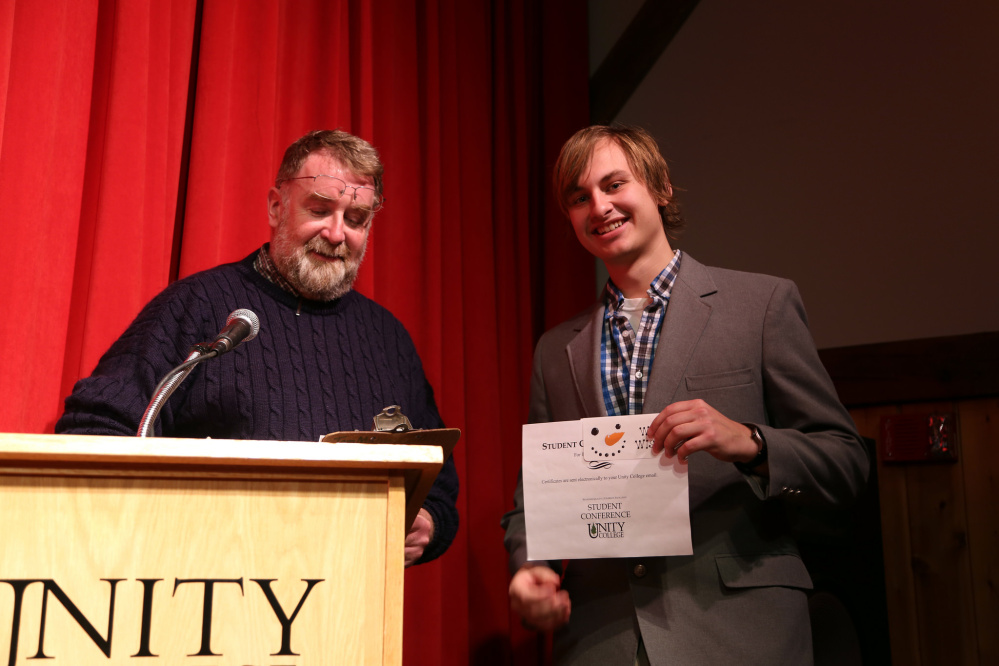 """Greg LeClair won the Environmental Stewardship Award for his """"YouTube Conservation: Using Modern Media for Saving Wildlife"""" during the Dec. 14 biannual Unity College Student Conference."""