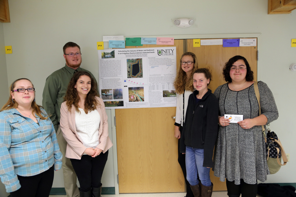 """The Environmental Professionals Award went to to Brian Harris-Jones, Cassandra Cates, Sean Stewart, Gunnar Norback, Emily MacDonald, Morgan DuBois, Alyssa Silvia and Sally Carullo, for """"Calculating the Volume of Water and Sediment in an Irrigation Pond at Johnny's Selected Seeds."""" The award was presented during the Dec. 14 biannual Unity College Student Conference. From left, are Cates, Stewart, Carullo, MacDonald, DuBois and Silvia."""