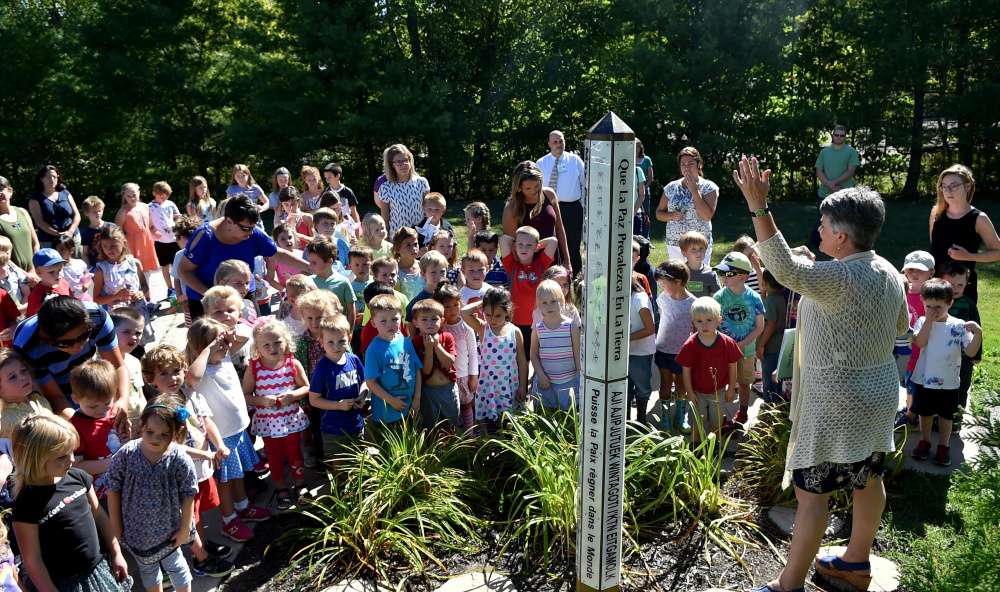 Kennebec Montessori students gather around the school's peace pole at their campus as they recognize National Day of Peace on Sept. 21 in Fairfield. The school is set to receive a $700,000 loan from the U.S. Department of Agriculture to build an addition to the school for expanded upper elementary-level classes.