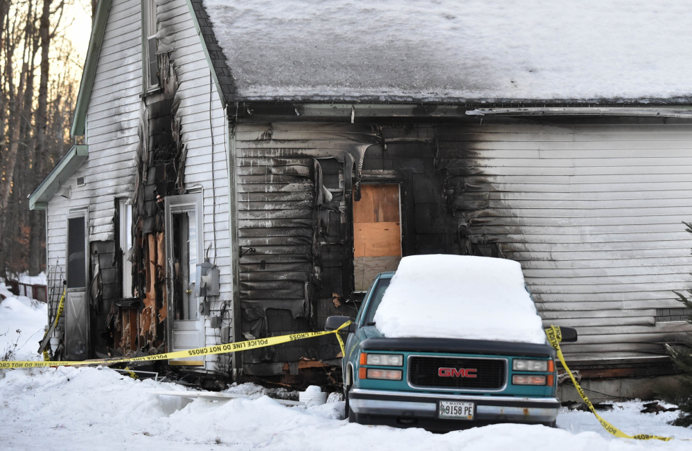 A house at 323 Norridgewock Road in Fairfield, seen Sunday, shows the damage that resulted when Terry Whitney set fire to the home of his estranged wife Dec. 25 before fatally stabbing himself.