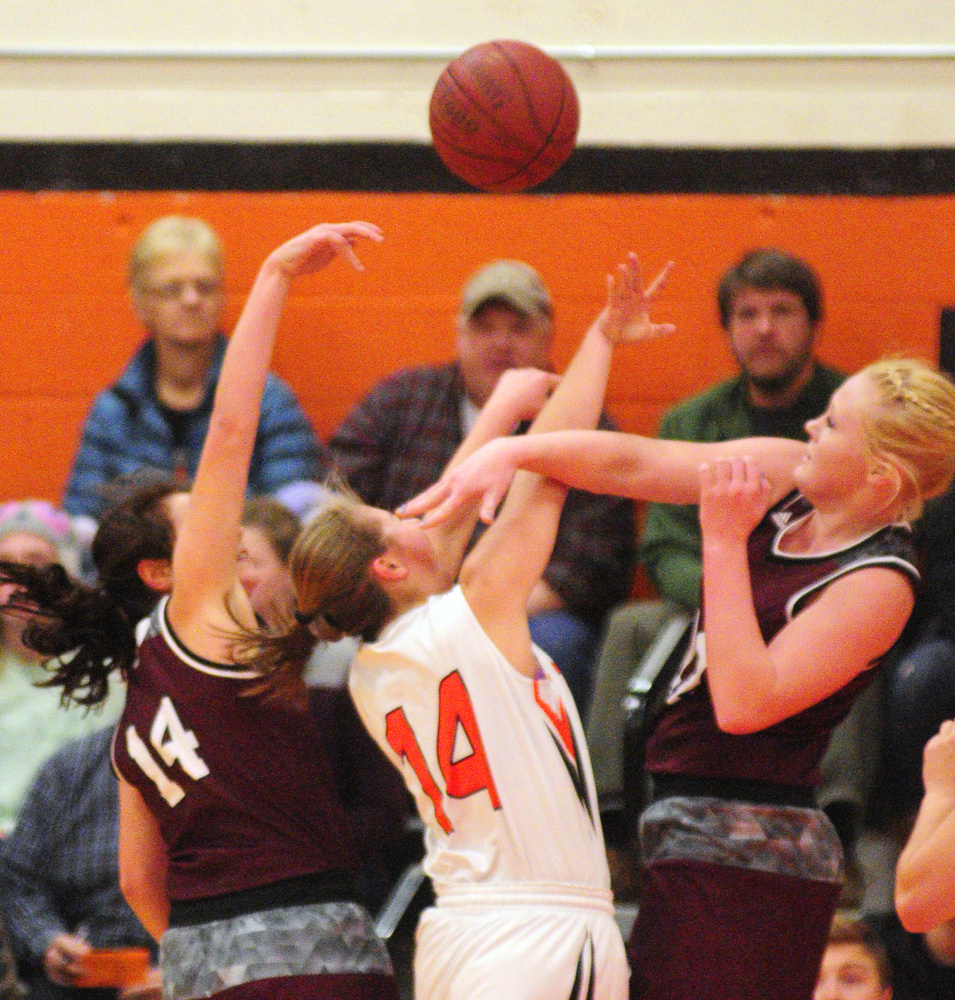 Nokomis defenders Chelsea Crockett, left, and Gabrielle Lord, right, converge on Gardiner junior guard Logan Granholm during a Kennebec Valley Athletic Conference Class A game Friday night in the James A. Bragoli Memorial Gym in Gardiner.
