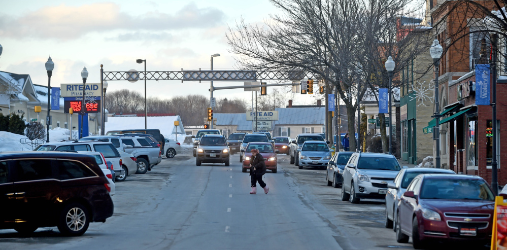 Traffic flows south Friday on Main Street toward the Bridge Street intersection in Waterville. A new traffic study proposes how two-way traffic could resume on Main Street as part of downtown revitalization efforts.