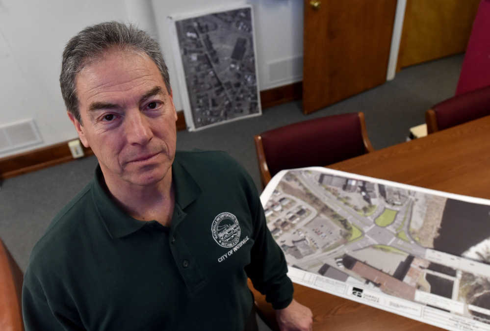 Mike Roy, Waterville's city manager, poses for a portrait Friday at his office with a rendering of the proposed traffic plans for downtown Waterville.