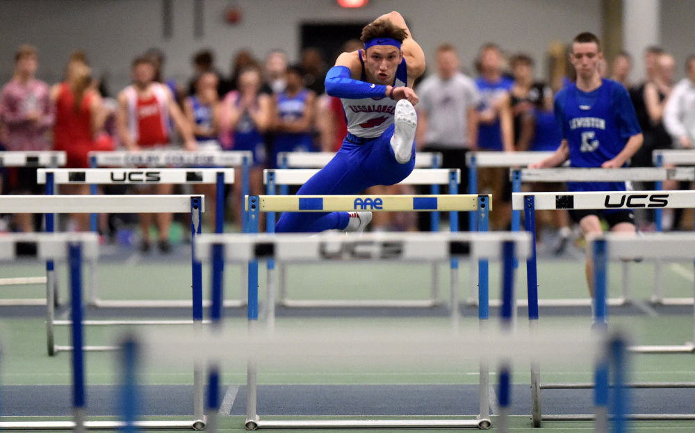Messalonskee runner Tanner Burton competes in the 55-meter hurdles during a Dec. 10 meet at Colby College.