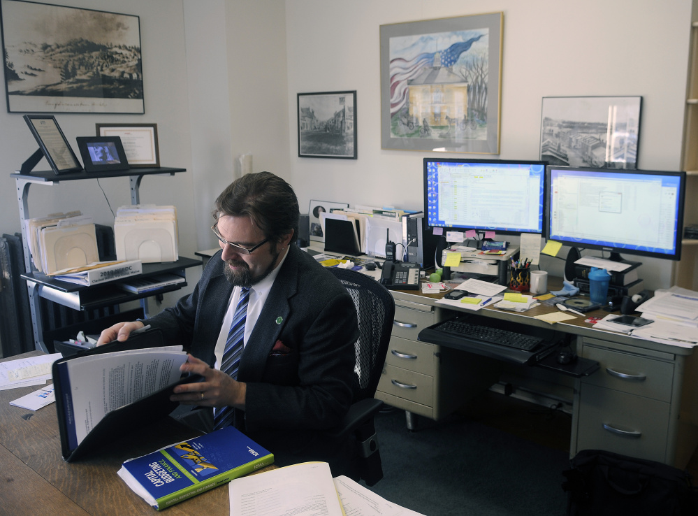 Hallowell City Manager Nate Rudy sits at his desk last week at City Hall.