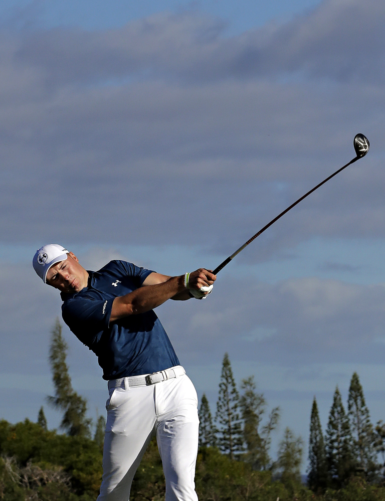 Jordan Spieth hits from the fourth tee during the final round of the Tournament of Champions on Sunda in Kapalua, Hawaii.