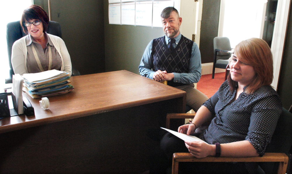 Diane Bryan, outgoing executive director of the Waterville Opera House, left; Nathan Towne, marketing director for Waterville Creates!; and the opera house's new executive director, Tamsen Brooke Warner, discuss changes at the organization on Monday.