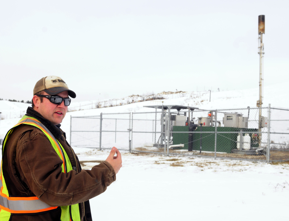 Lane Gould, technical supervisor at Hatch Hill, talks about the methane flare on Tuesday at Hatch Hill landfill in Augusta.