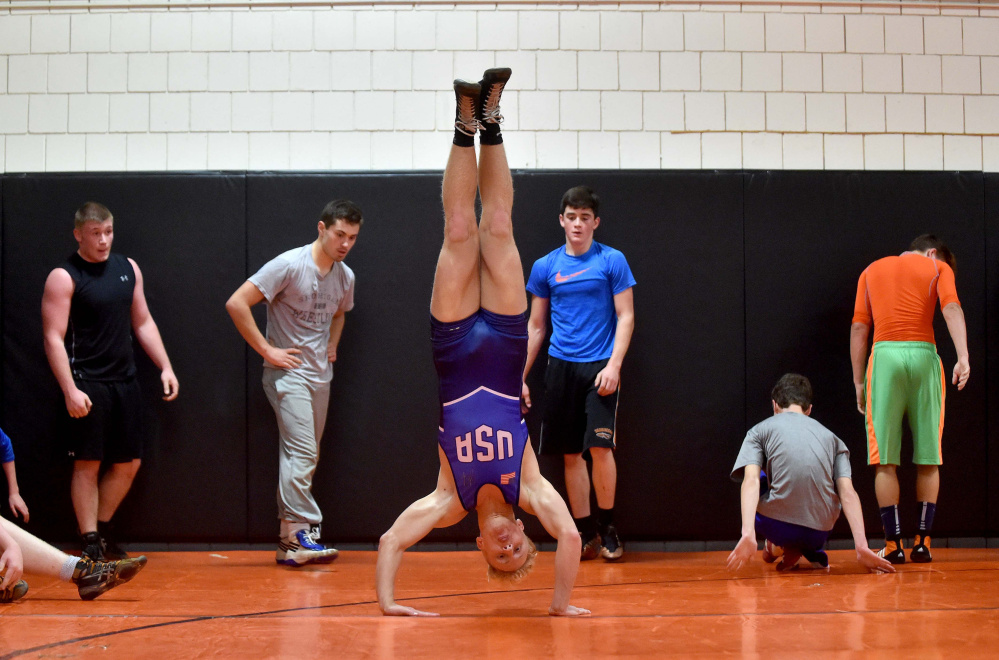 Cooper Holland works out during a recent Skowhegan wrestling practice.