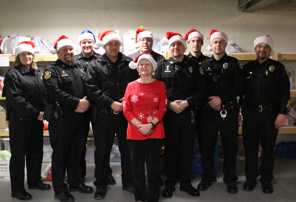 Dispatcher Jeanne Kempers is in front. Second row, from left, are Officer Casey Dugas, Sgt. Matt Wilcox, Officer Jacob Boudreau and Officer Patrick Manka. In back, from left, are Officer Shanna Blodgett, Sgt. Matthew Bard, Chief Tom Gould, Officer Blake Wilder and Capt. Paul St. Amand.