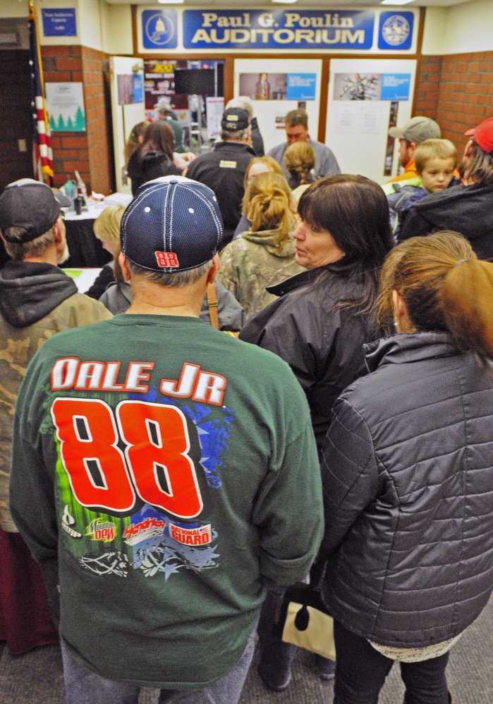 Motorsports enthusiasts, including Benton native Howard White, wait in line to enter the Northeast Motorsports Expo last year in the Augusta Civic Center. The annual show returns to the Civic Center on Friday.