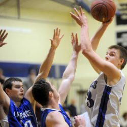 Erskine junior Noah Bonsant puts up a shot over Lawrence defenders during a Jan. 6 Kennebec Valley Athletic Conference Class A game in South China.