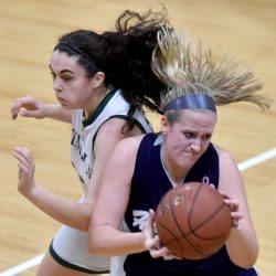 Temple's Kiara Carr, left, closes in on Highview Christian's Grace Rossignol during a Class D South game Friday afternoon in Waterville.