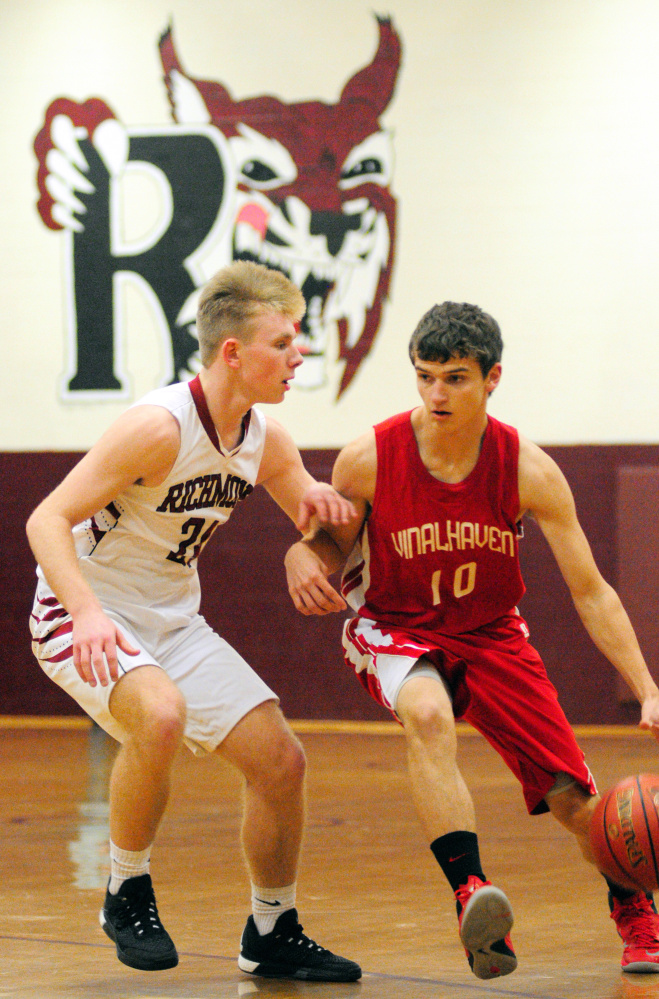 Richmond's Brendan Emmons, left, defends Vinalhaven's Max Stanley during a game Friday in Richmond.