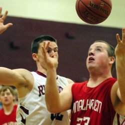 Richmond's Matt Holt, left, and Vinalhaven's Cody Hamilton go for a rebound during a game Friday in Richmond.