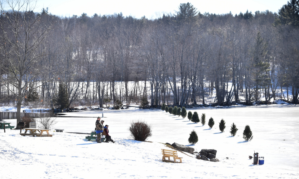 A row of trees marks the end of the safe ice on Messalonskee Lake in Oakland on Saturday.