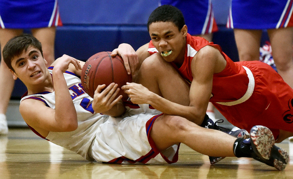 Messalonskee's Chase Warren, left, battles for the loose ball with Cony's James Hunt on Saturday in Oakland.