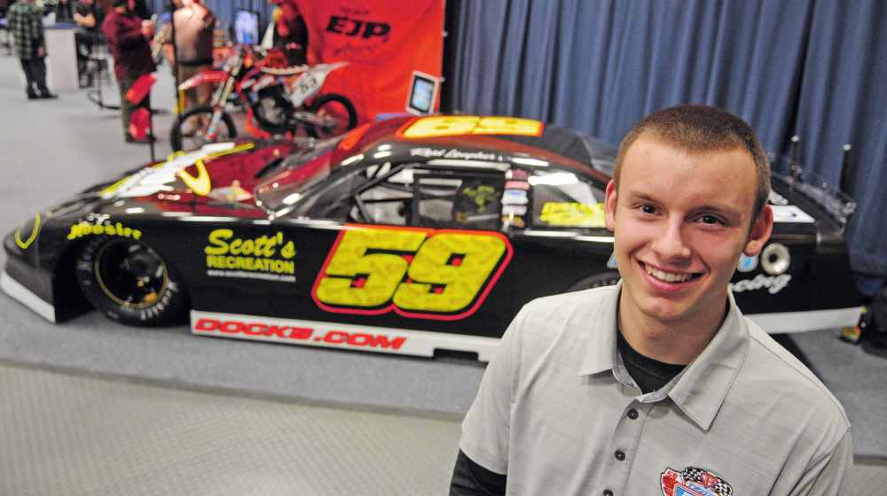 Staff photo by Joe Phelan   Reid Lanpher poses beside his race car during the Northeast Motorsports Expo on Saturday at the Augusta Civic Center.
