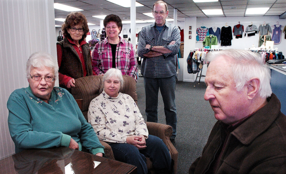 Volunteers with the new St. Peter's Thrift Store and Food Pantry in Bingham discuss the opening of the store at the former Jimmy's Market on Main Street on Wednesday. In front from left are Violet Tibbets, Aldea LeBlanc and Jim West. In back row from left are Carolyn Fultz and Marsha and Sonny Lagasse. The store will be open Thursdays and Saturdays from 10 a.m. to 2 p.m.