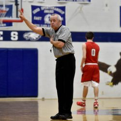 Rocky Buck officiates a game between Cony High School and Messalonskee High School on Saturday in Oakland.