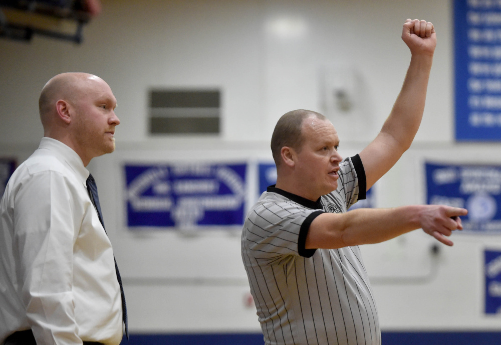Randy Caswell officiates a game between Cony High School and Messalonskee High School on Saturday in Oakland.