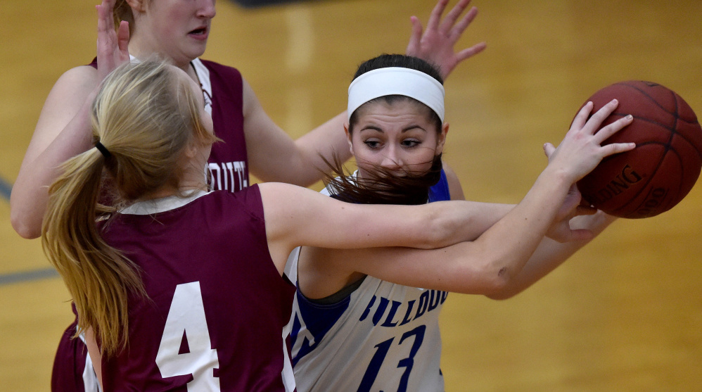 Madison freshman Emily Edgerly, right, looks to pass the ball as Monmouth sophomore guard Julia Johnson defends during a Mountain Valley Conference game Tuesday night.