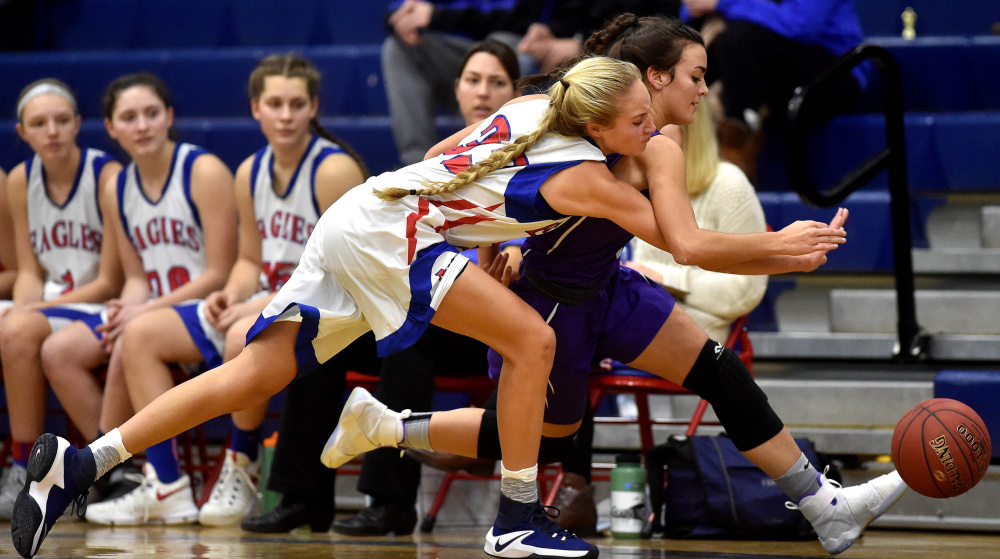Messalonskee's Ally Turner, left, battles for a loose ball with Waterville's Jordan Jabar during a Kennebec Valley Athletic Conference Class A game earlier this season in Oakland.