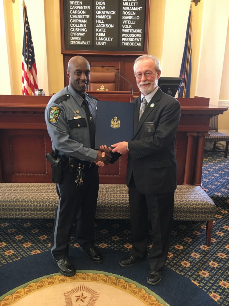Officer Tim Williams, left, was recently presented with a Legislative Sentiment by Sen. Rodney Whittemore .