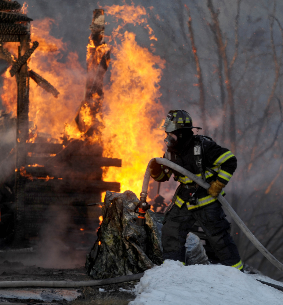 Firefighters from several area fire departments battle a house fire Jan. 13 on China Road in Winslow.