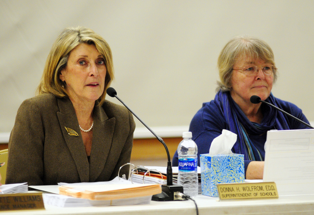 Superintendent Donna Wolfrom, left, speaks beside board Chairwoman Terri Watson during a Regional School Unit 38 board meeting Wednesday at Maranacook Community School in Readfield, where parents and teachers expressed concern about mold at Manchester Elementary School.