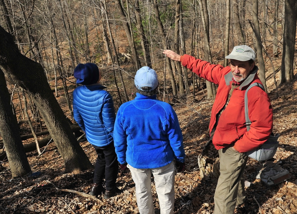Sue Bell, left, City Councilor Dale McCormick and Brian Kent look down on Kennedy Brook on April 18, 2014, during a walking tour of Howard Hill in Augusta. The Augusta City Council voted Thursday night to accept the land from the Kennebec Land Trust.