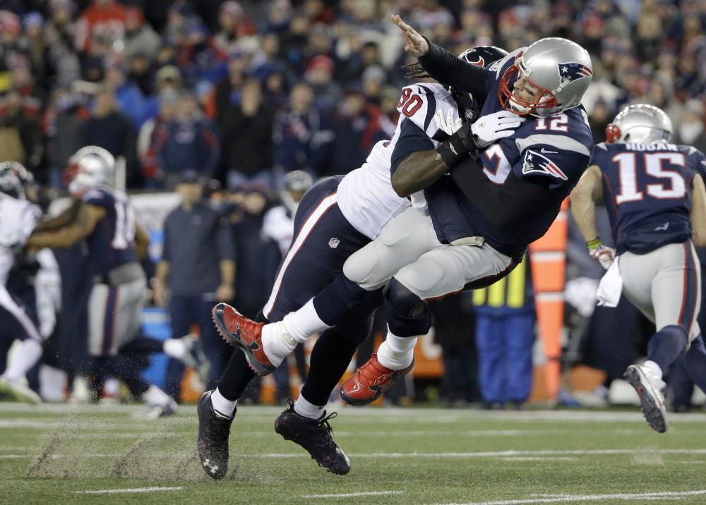 Houston Texans defensive end Jadeveon Clowney levels New England quarterback Tom Brady after Brady released a pass during the first half of a divisional playoff game in Foxborough, Massachusets last weekend.