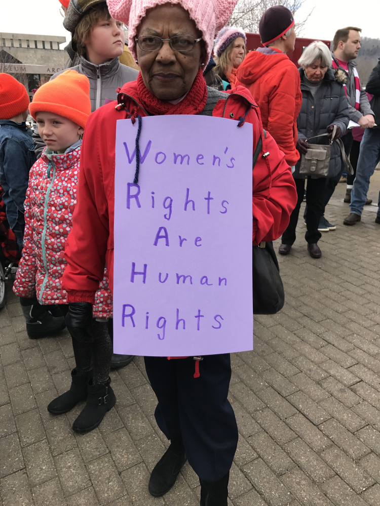 Lovye Oesterlin takes part Saturday in the Women's March on Maine at the State House in Augusta.