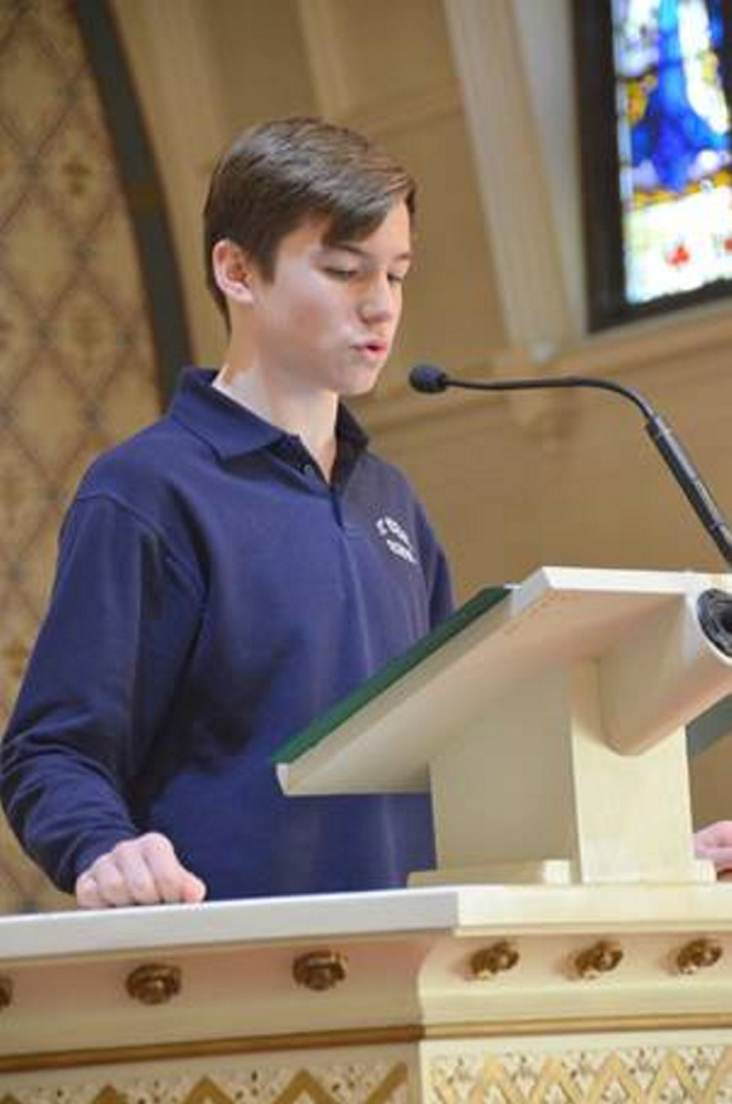 Camden Cotnoir speaks during Mass at the Assumption Church.