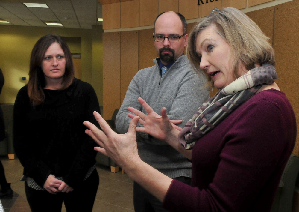 University of Maine Farmington professor Kelly Bentley, right, speaks Monday with Tricia Plourde and Ryan Goding of Western Maine Homeless Outreach shelter about the work her studenrs performed to gain a $5,000 grant from Skowhegan Savings Bank for the shelter.